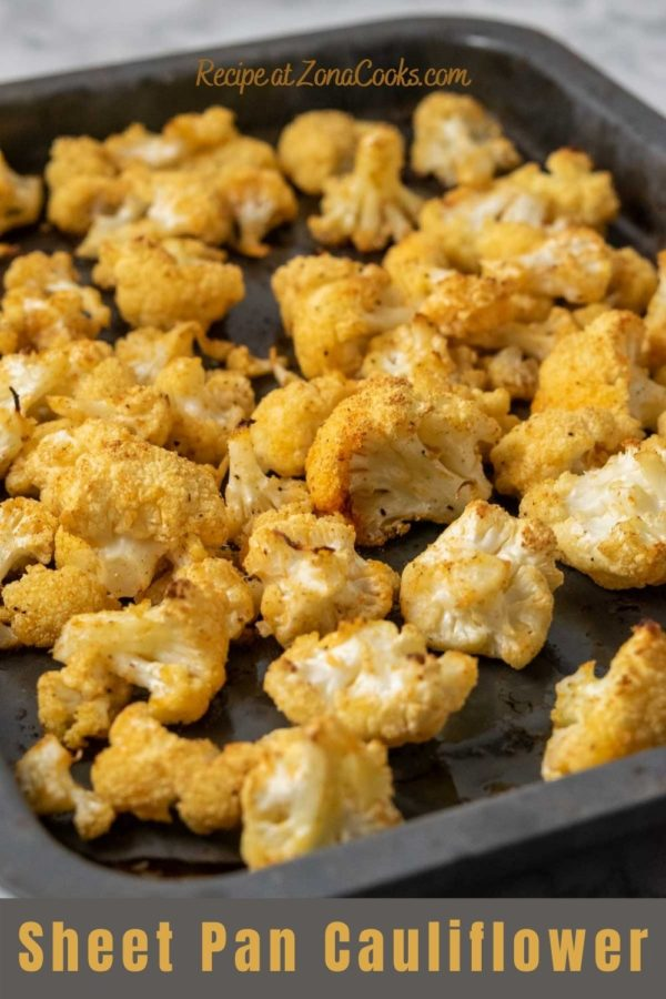 a small baking sheet pan filled with golden brown oven baked cauliflower florets and text reading recipe at zonacooks.com sheet pan cauliflower