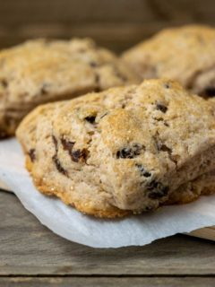 fluffy golden brown scones filled with cinnamon and raisins and topped with coarse sugar