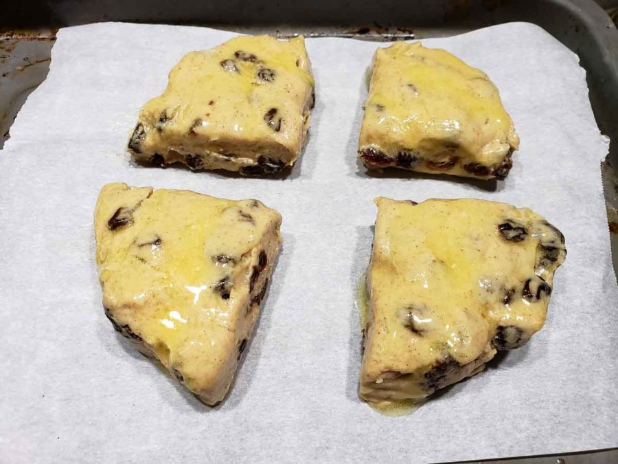 melted butter brushed on top of 4 scone dough triangles