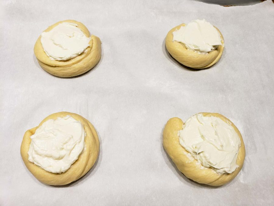 four crescent dough circles filled with cream cheese filling