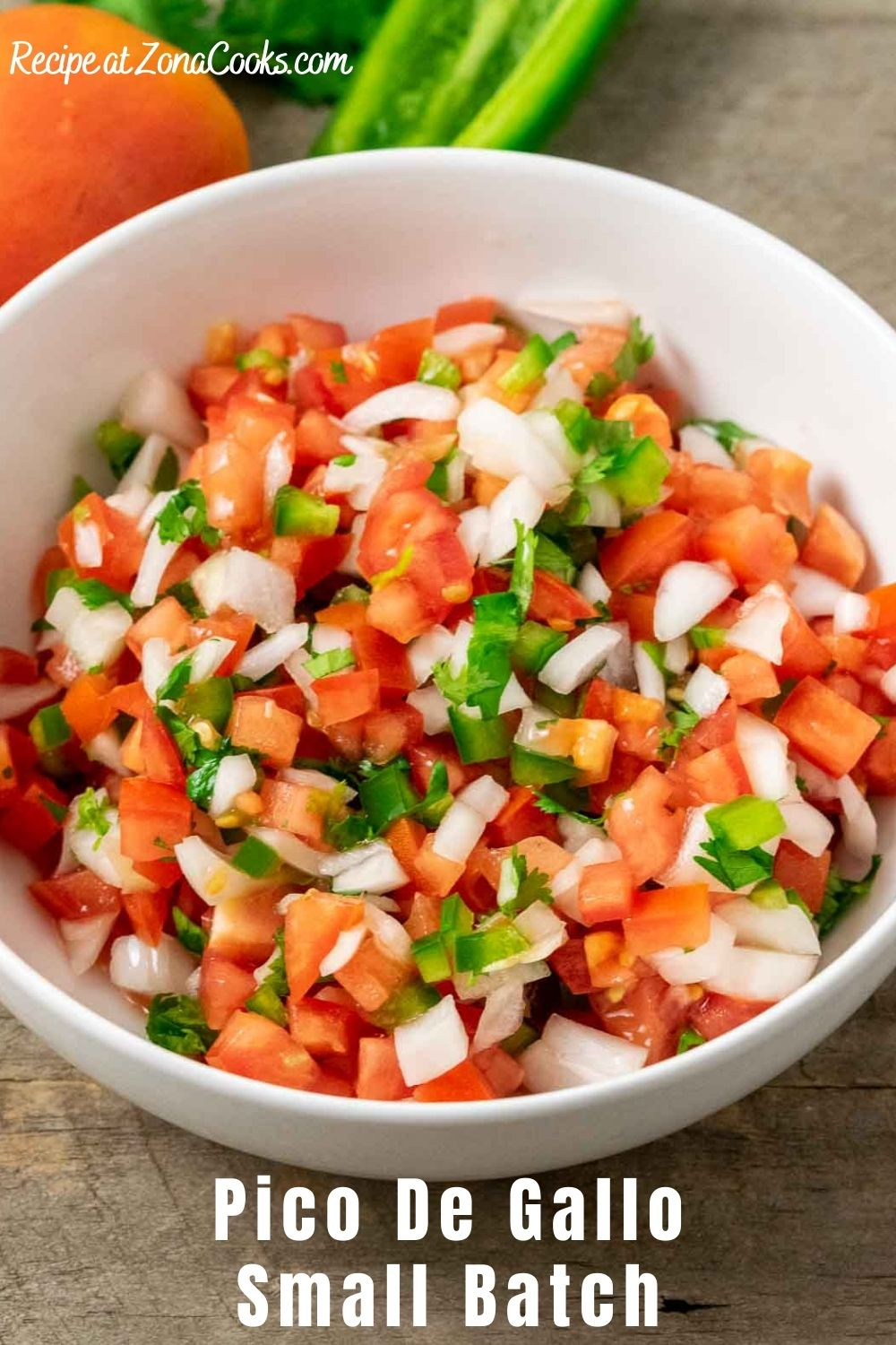 chopped tomato, onion, and jalapeño peppers , with salt, lime juice, and cilantro mixed in a bowl and text reading recipe at zonacooks.com pico de gallo small batch.