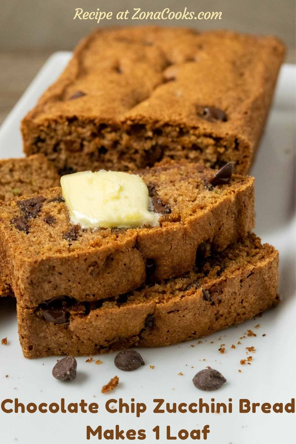 a loaf of chocolate chip zucchini bread with 3 slices laying down topped with butter and text reading recipe at zonacooks.com chocolate chip zucchini bread makes 1 loaf.