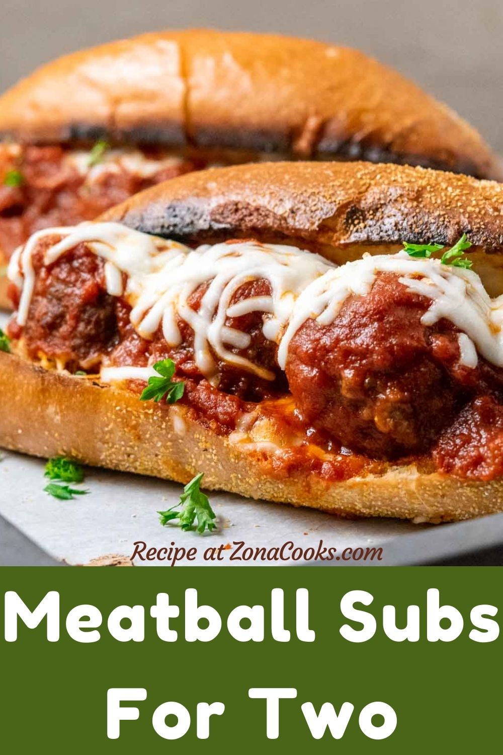 two meatball subs on a tray and text reading recipe at zonacooks.com meatball subs for two.
