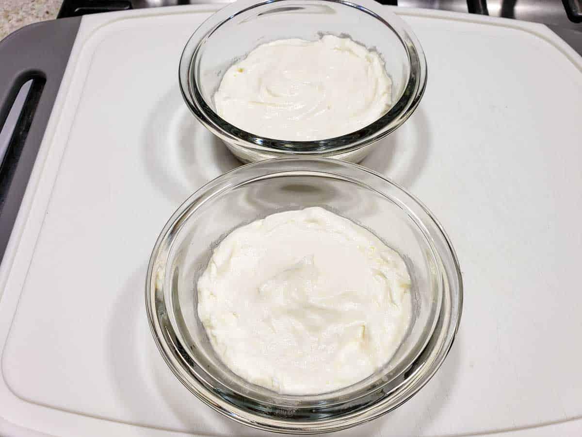 cream cheese mixture spread on top of pretzel crust in custard cups.