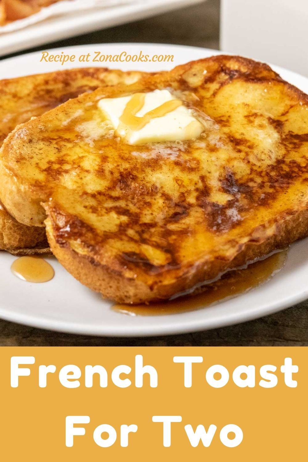 two thick slices of texas toast french toast topped with butter and syrup and text reading french toast for two recipe at zonacooks.com.