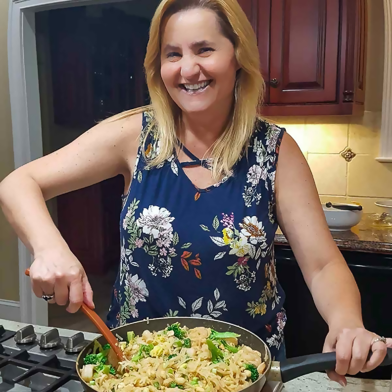 Zona stirring food in a pan.