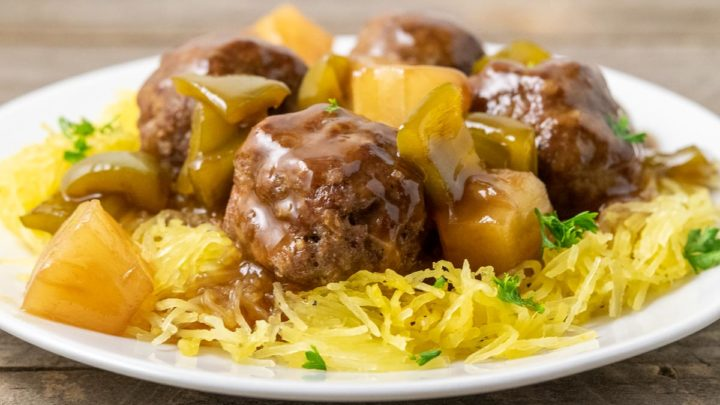 a plate filled with Spaghetti Squash and Hawaiian Meatballs, pineapple, and green peppers.