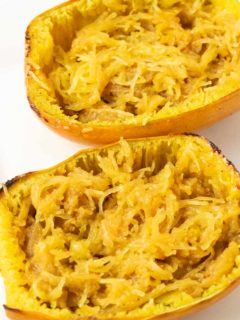 two halves of Spaghetti Squash with Brown Sugar, cinnamon, and butter.